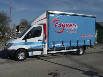Aluminium curtain side body complete with 500 k column tail lift mounted to Mercedes Sprinter chassis.